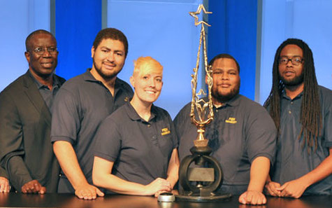 Coach Cargill (left) and the winning team from Fisk University